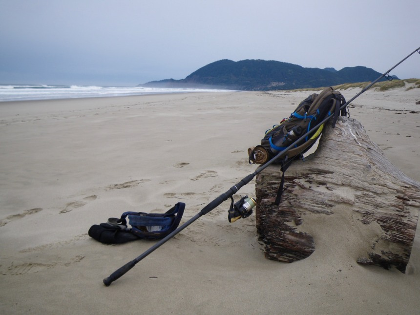 My gear on a log; tides way out with a lot of sandy beach exposed