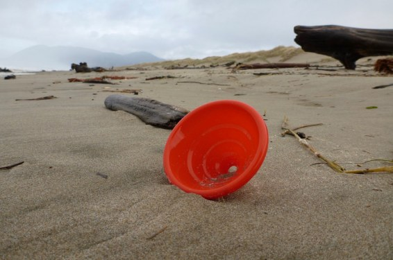 a bright orange-red plastic funnel