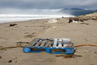 blue pallet on sand