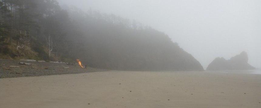 A distant bonfire on the beach