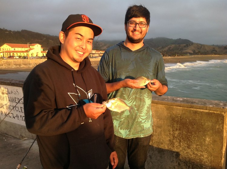 Mike and Saad with walleye and calico