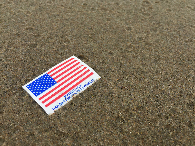 American flag sticker on the sand