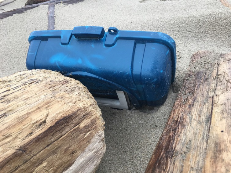 blue plastic tool box or tackle box lid up in the wrack