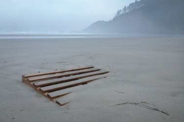 half buried, foggy beach