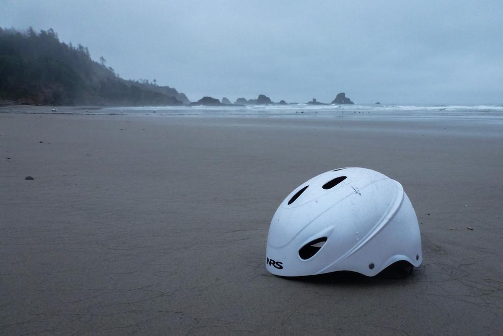 White NRS whitewater paddling helmet in the drift line