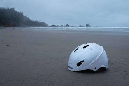 White NRS whitewater paddling helmet in the drift line