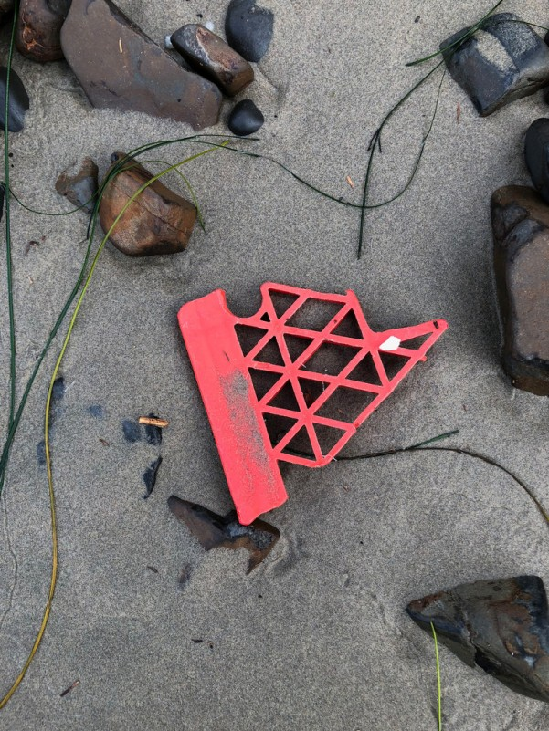 fragment of a red fish crate