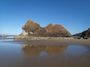 An iconic rock jutting seaward