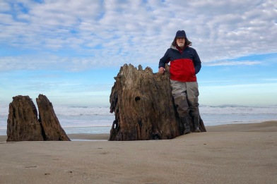 Me standing next to the stump, the sand about 6 feet higher that when I first came across the stump