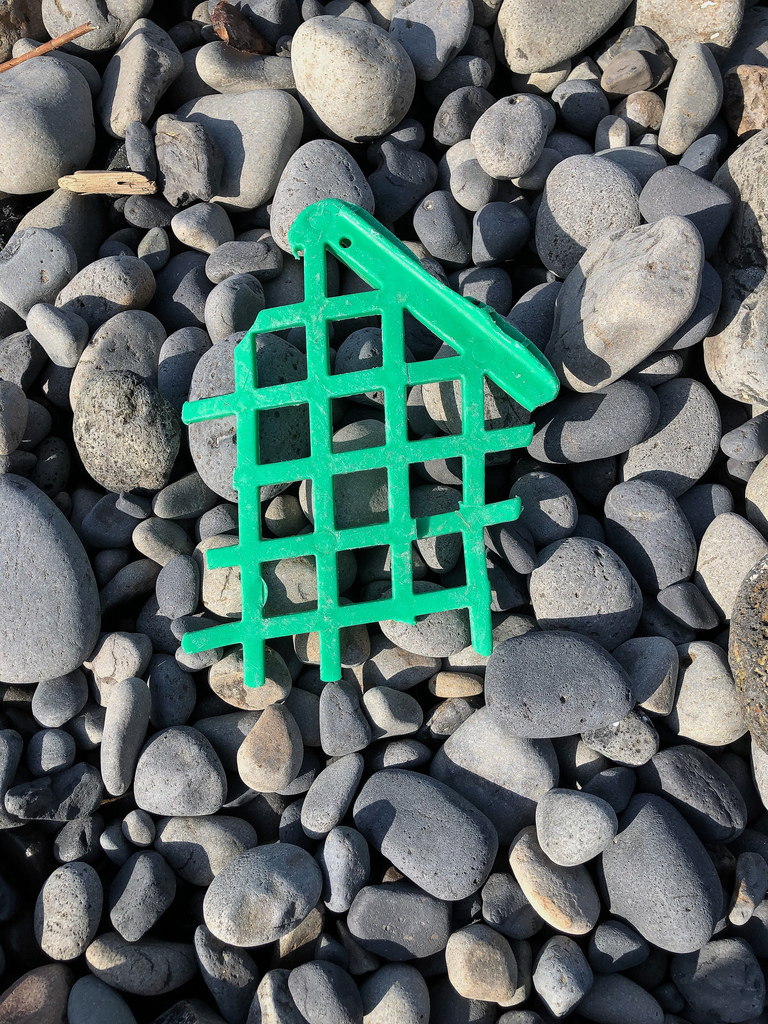 Green fish crate fragment